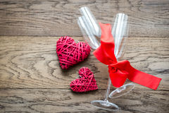 Two flutes with retro cane hearts on the wooden background Royalty Free Stock Photography