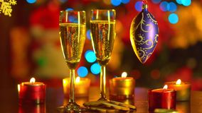 Two Flutes with Sparkling Champagne with New Year. Two Flutes with Sparkling Champagne over New Year Tree Lights stock video
