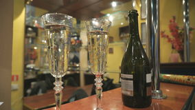 Two Flutes with Sparkling Wine over Holiday. Couple of champagne Glasses closeup. Success celebrating stock video footage