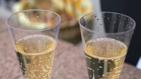 Two Flutes with Sparkling Wine over Holiday. Couple of champagne Glasses closeup. Success celebrating stock footage