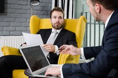 Two business people talking in a modern office Stock Photo
