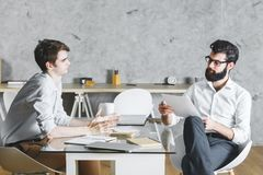 Two focused businessmen working on project together Royalty Free Stock Images