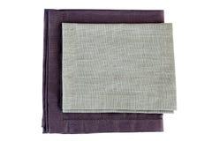 Two folded gray textile napkins on white Stock Photography