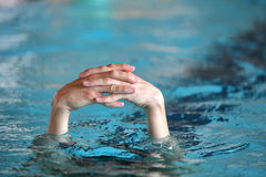 Two folded hands above water Stock Photos