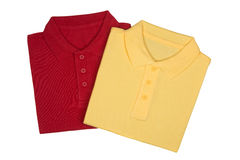 Two folded red and yellow polo shirts isolated on white Royalty Free Stock Photo