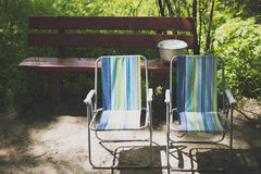 Two folding chair outdoors stock photos