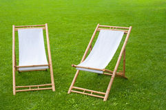 Two folding chairs in a green park Royalty Free Stock Images