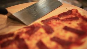 Two footage. Pizza with cheese and pizza paddle on stock video