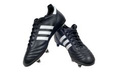 Two football boots. With stripes stock images