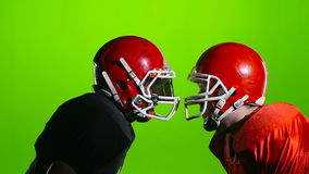 Two football face protective helmets in battle. Green screen. Slow motion stock video footage