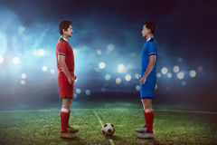 Two football player facing each other. On the kickoff at the stadium stock photo