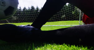 Two football players striking a ball in the field stock video footage