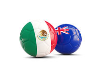 Two footballs with flags of Mexico and New Zealand isolated Stock Image