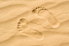 Two footprints in the sand Royalty Free Stock Images
