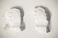 Two Footprints in the Snow. Winter scene of two footprints in the snow Stock Image