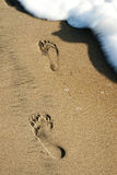Two Foots Prints in the Sand Royalty Free Stock Photography