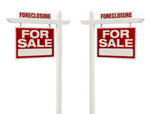 Two Foreclosure For Sale Real Estate Signs with Clipping Path Stock Image