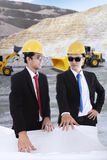 Two foremen meeting at mining sites Stock Image