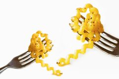 Two fork with swirl pasta fusilli col buco on white background Stock Image
