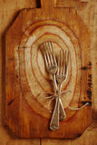 Two fork tied by string on old wood Royalty Free Stock Photography