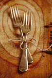 Two fork tied by string on old wood Stock Photo