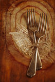 Two fork tied by string on old wood, selective focus, shallow do Stock Photos