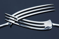 Two forks. Brightly lit forks on a dark background Stock Photo
