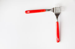 Two forks forming a corner. Corner made of two forks on neutral background Stock Photos