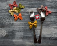 Two forks in love. On the wooden background Royalty Free Stock Photo