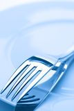 Two forks on a plate Stock Photography