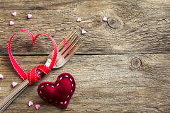 Two forks and red hearts Stock Image