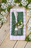 Two forks on rustic wooden background and branches. With flowers Royalty Free Stock Photography