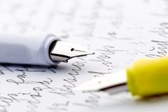 Two fountain pens on a letter.  stock photography