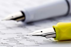 Two fountain pens on a letter.  stock image