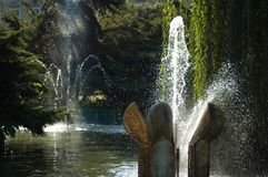 Two fountains. Stone fountains in water basin Stock Photography