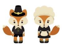 Two foxes pilgrims Royalty Free Stock Photo