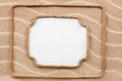 Two frame made of rope lying on the sand with a white background Stock Photo