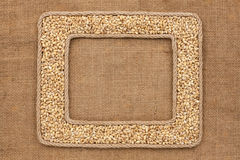 Two frame made of rope with pearl barley on sackcloth Royalty Free Stock Photo