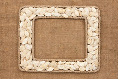 Two frame made of rope with pumpkin seeds on sackcloth Royalty Free Stock Photography