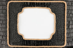 Two frame of rope, lies on a background of a black crocodile skin Stock Photos