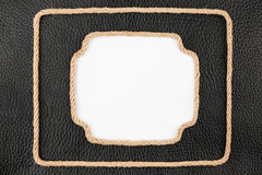 Two frame of rope, lies on a background of a black natural leath Royalty Free Stock Photos
