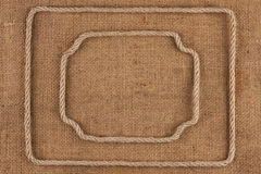 Two frame of rope, lies on a background of burlap Stock Photography
