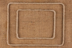 Two frame of rope, lies on a background of burlap Royalty Free Stock Photos