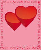 Two framed hearts. On a pink background Stock Photos