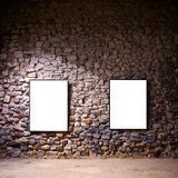 Two Frames. Two empty frames attached to a stone wall in a gallery room Royalty Free Stock Photography
