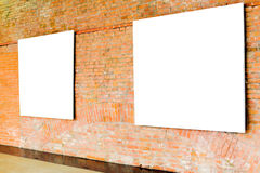 Two frames on brick wall royalty free stock image