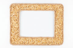 Two frames made of the rope with oats grain on a white backgroun Royalty Free Stock Photography