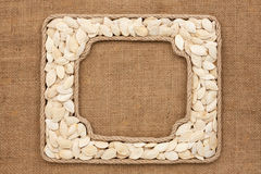 Two frames made of rope with pumpkin seeds on sackcloth Royalty Free Stock Photography