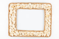 Two frames made of the rope with pumpkin seeds on a white backgr Royalty Free Stock Image