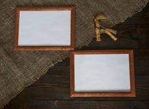 Two frames with a toy. Two frames on wooden background with a toy Royalty Free Stock Image